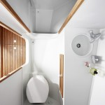 Firmship FS 42 - bath finished in teak and Corian featuring standing shower facility 600x900px