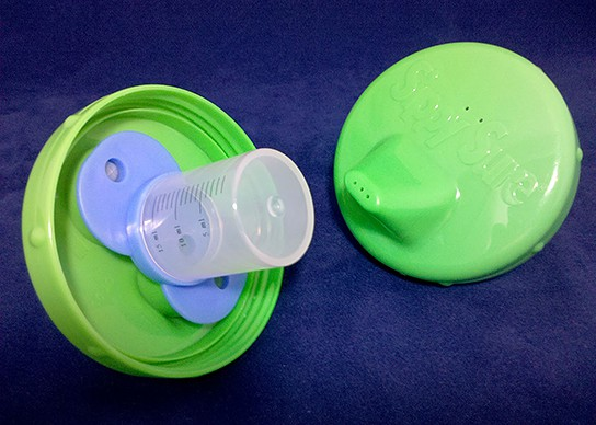 Sippy Sure - cup top with medicine cup and valve base attached 544x388px
