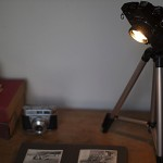 a desk lamp crafted out from tripod and camera