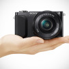 Sony NEX-3N Mirrorless Digital Camera - Black with hand