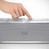 Loewe Speaker 2go NFC-enabled Bluetooth Speaker - Silver with hand