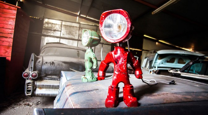 This Desk Lamp Has A Superhero Stance And A LED-equipped Tractor Headlight
